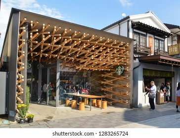 Dazaifu, Japan - November 19, 2018: Tourists are visiting Starbucks Dazaifu, the unique architectural design Starbucks, near Dazaifu Tenmangu Shrine entrance, Japan