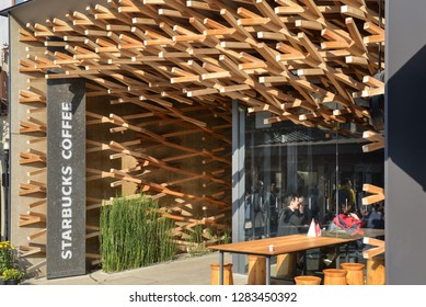 Dazaifu, Japan - November 19, 2018: Starbucks Dazaifu, decorated with weaving of cedar wood, is seen along the street near Dazaifu Tenmangu Shrine entrance, Japan