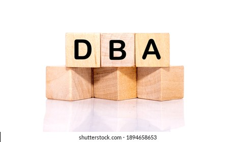 DBA acronym from wooden blocks with letters, DataBase Administrator or doing business as abbreviation DBA concept