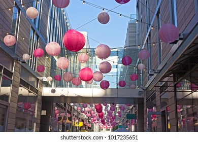 DC City Center features shops and restaurants along pedestrian alley brighten by pastel colored balloons, Washington DC, USA. A festive atmosphere accompanies cherry blossom events in US capital.