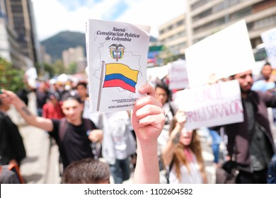 Bogotá, Bogotá D.C. / Colombia 31-May-2018 A man shows the political constitution of Colombia in the march against the electoral results of Colombia