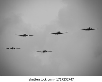 D-Day celebrations with parachutists and Dakotas above Europe, France, Belgium and the Netherlands. Anniversary of the battle of Normandy. (DDay, D'Day, World War II or Second World War).