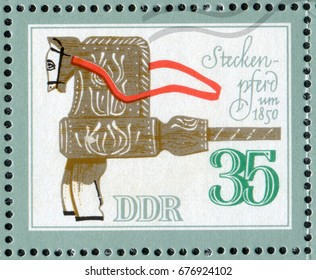 """DDR- CIRCA 1981: A post stamp printed in DDR (Germany) shows a wooden Horse Toy of the 1800 year. From the series """"Historical Toys Animals"""", circa 1981"""