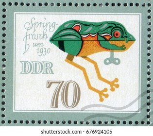 """DDR- CIRCA 1981: A post stamp printed in DDR (Germany) shows a Spring Frog Toy of the 1930 year. From the series """"Historical Toys Animals"""", circa 1981"""