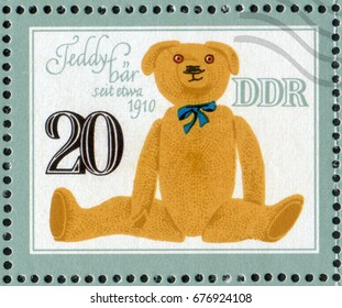 """DDR- CIRCA 1981: A post stamp printed in DDR (Germany) shows a Teddy Bear stuffed toy of the 1910 year. From the series """"Historical Toys Animals"""", circa 1981"""