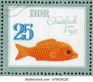 """DDR- CIRCA 1981: A post stamp printed in DDR (Germany) shows a Gold Fish Bathing Toy of the 1935 year. From the series """"Historical Toys Animals"""", circa 1981"""