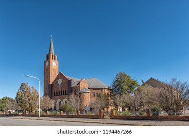 DE AAR, SOUTH AFRICA, AUGUST 6, 2018: A street scene, with the Dutch Reformed Mother Church and Hall, in De Aar in the Northern Cape Province