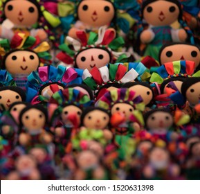 Peña de Bernal, Mexico - Nov 2018 The dolls are made of cloth and are dressed similar to the traditional dress of Mazahua women, an indigenous group found in the State of Mexico and Michoacán.