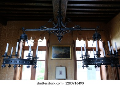 Château de Chaumont, Loire valley, France - April 28, 2018: Wonderful wrought iron chandelier over the pool table within the château