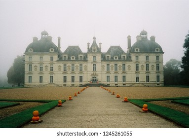 Château de Cheverny, France - Nov, 2018 : Chateau de Cheverny decor by pumpkin to celebrate Halloween in a foggy day taken by lomography 800 film