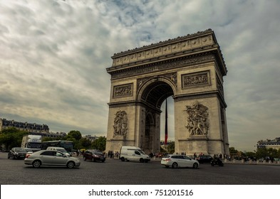 """Arch de Triomphe""-A cloudy day in Paris as traffic circles the Arch de Triomphe, France, September 2017"