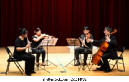 De focused/ Blurred image of a string quartet performing.
