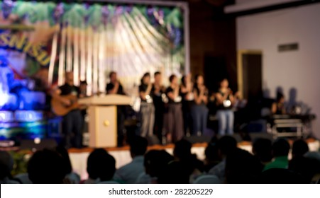 De focused or blurred people worshiping for spiritual or religion background
