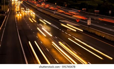De focused car lights at a highway