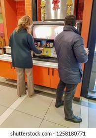 Alcalá de Henares, Madrid, Burgerking, 12/12/2018, People serving carbonated drinks in the burger king