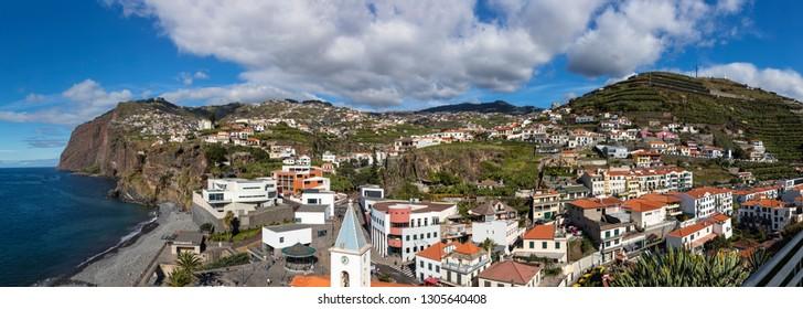 CÂMARA de LOBOS, MADEIRA - JANUARY 23, 2019: Panoramic seafront view of Câmara de Lobos and Cabo Girão, Madeira