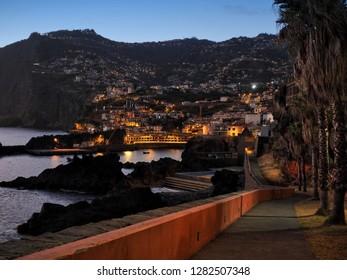 Câmara de Lobos in Madeira, Portugal, during sunset, night, evening, harbour town, fishing, romantic, palms, lights, sea, ocean, port, marine, Ponta do sol, relax, meditation, quiet, peace