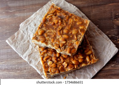 """""""Pé de Moleque"""" is a typical sweet of Brazilian cuisine, made with roasted peanuts and rapadura. it is called chikki in India, nougat in Portugal and palanqueta in Mexico. Selective focus"""