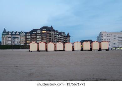 De Panne, Belgium - 19 April 2019: Vintage beach huts on the Belgian coast