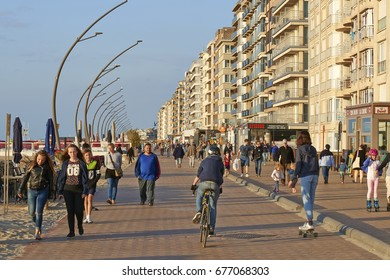 DE PANNE, BELGIUM - JULY 03, 2017: Promenade of the Belgian Seaside resort De Panne with lot of people walking