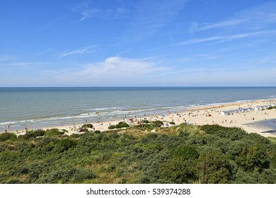 DE PANNE, BELGIUM - JULY 06, 2016: Lot of people enjoy the Belgian Coast in Summer at De Panne, Belgium