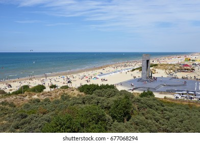 DE PANNE, BELGIUM - JULY 09, 2017: Lot of people enjoy the Belgian Coast in Summer at De Panne, Belgium