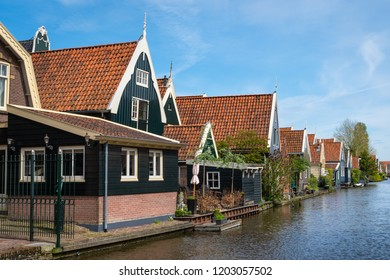 De Rijp, Middenbeemster, North Holland, Netherlands - May 1, 2018 : Typical green houses along the canal in De Rijp