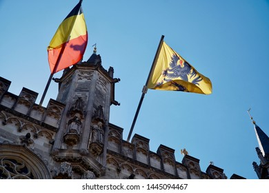 De Vlaamse Leeuw proudly waving on top of the city hall in Bruges