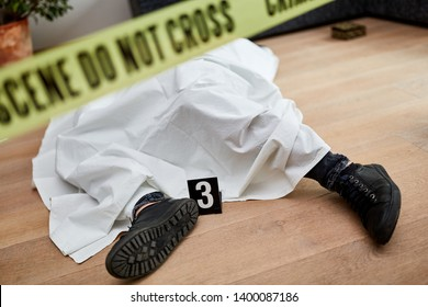 Dead body after murder at the scene after forensics by the police