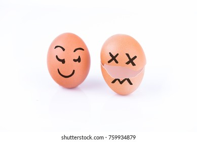 Dead egg with evil egg beside you on white background
