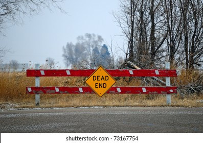 Dead end sign could represent various jobs or relationships. The gloomy sky adds to the feeling of frustration.