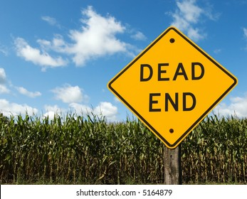 Dead end sign in front of a corn field