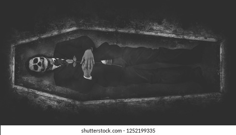 The dead man's body cradled in a casket in a hole with black roses on his chest. The face became a skull because of the bruising from disappointment in love. And alone in a dark world alone.