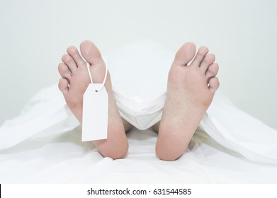 Dead man's foot on white background