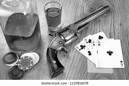 Dead mans hand aces and eights with Wild Bill's six shooter in black and white.