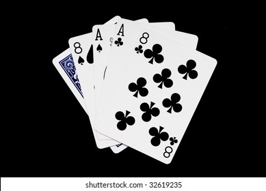 Dead Mans Hand of Cards isolated on a black background