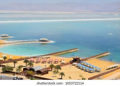 Dead Sea, Ein Bokek, Israel - March 18: view of the beach at resort village of Ein Bokek on March 18, 2018 in Ein Bokek, Dead Sea, Israel