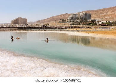 Dead Sea, Ein Bokek, Israel - March 18: vacationers and tourists bathe in the Dead Sea on the background of luxury hotels on March 18, 2018