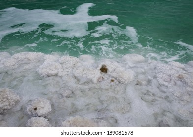 dead sea with green water on shoreline