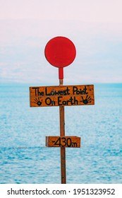 The Dead Sea, Israel. The sign says that the Dead Sea in Israel is in meters the lowest point on earth, 430 meters