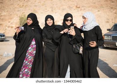 DEAD SEA, JORDAN - AUGUST 12, 2016: three unidentified women from Yemen enjoying their holiday traveling alone to Jordan