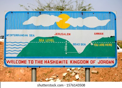 Dead Sea / Jordan - March 8 2018: Road sign showing details of the Dead Sea elevation in comparison with the Mediterranean Sea. Board welcoming tourists to the Hashemite Kingdom of Jordan.