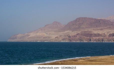 dead sea Middle East desert sand stone hills and mountain waterfront shoreline scenic view of Jordan