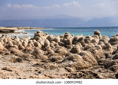 The Dead Sea is a salt lake in Israel at the lowest point on earth of 430 meters below sea level. The drop rate of the sea surface is 1 meter per year causing appearance of sinkholes and salt crystals