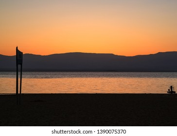 Dead Sea sunrise with Jordan mountains in background; lowest point on Earth