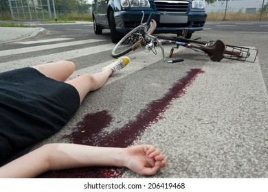 Dead woman after car accident on the street
