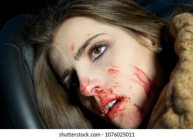 Dead woman in car on wheel