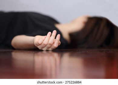 dead woman's body focus on hand