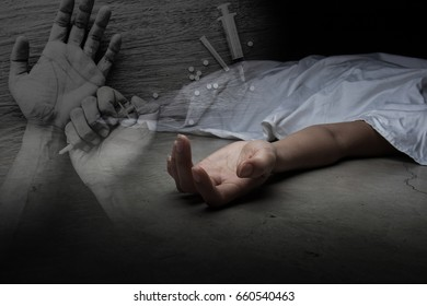 The dead woman's body. Focus on hand with drug background