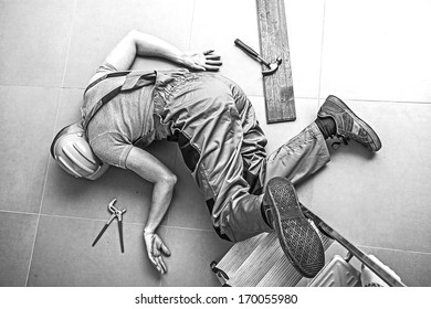 A dead worker on the floor after an accident